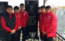 Academy players hitting their trophy in honor of their late skipper
